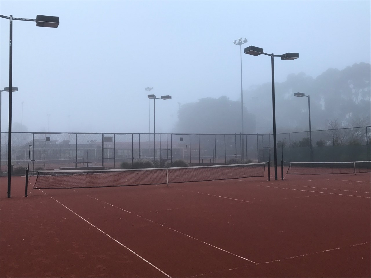 Courts in fog